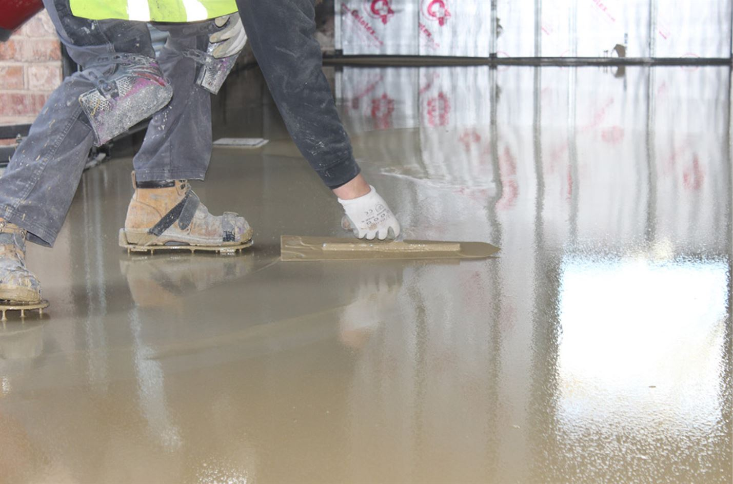 Self Levelling Compound Concrete Screed being laid by worker - UK Supplier